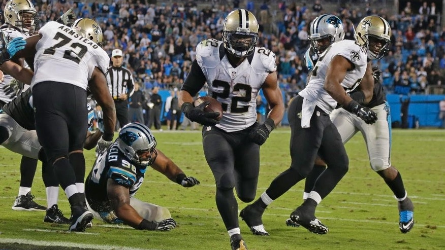 New Orleans Saints' Mark Ingram (22) runs into the end zone for a touchdown against the Carolina Panthers in the second half of an NFL football game in Charlotte, N.C., Thursday, Oct. 30, 2014. (AP Photo/Bob Leverone)