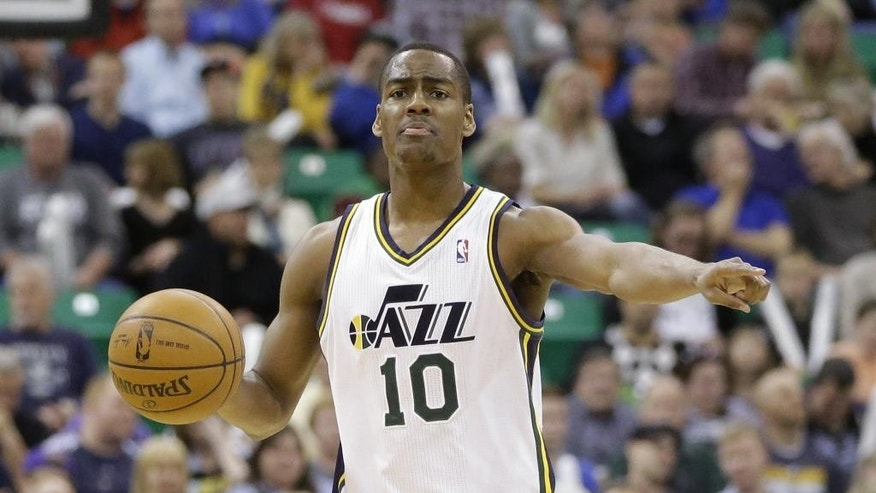 FILE - This is an April 4, 2014, file photo showing Utah Jazz's Alec Burks (10) bringing the ball up court in the second half during an NBA basketball game against the New Orleans Pelicans in Salt Lake City. A person with knowledge of the deal tells The Associated Press that the Utah Jazz have agreed with guard Alec Burks on a four-year, $42 million extension that could be worth $45 million after incentives.  The deal was reached on Friday, Oct. 31, 2014,  and was first reported by Yahoo! Sports. The person requested anonymity because an official announcement had not been made.  (AP Photo/Rick Bowmer, File)