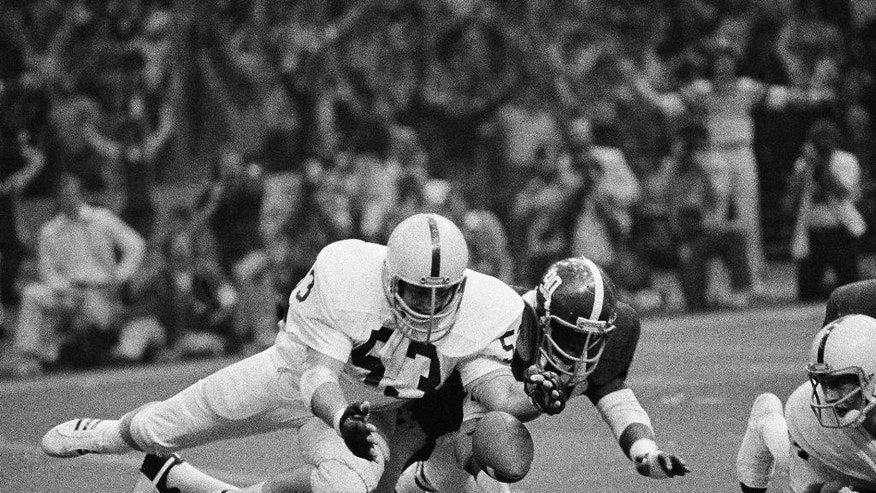 FILE - In this Jan. 1, 1979, file photo, Penn State's Jim Romano (53) recovers the fumble from his quarterback as Alabama Thomas Boyd tries for the ball during the first half of the Sugar Bowl in New Orleans. The second-ranked Crimson Tide beat the top-ranked and undefeated Nittany Lions, making fourth-quarter goal line stand that goes down as one of the most famous in college football history. (AP Photo/File)