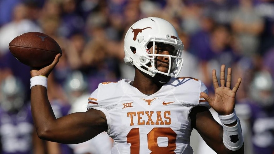 Texas quarterback Tyrone Swoopes (18) throws a pass during the first half of an NCAA college football game against Kansas State in Manhattan, Kan., Saturday, Oct. 25, 2014. (AP Photo/Orlin Wagner)