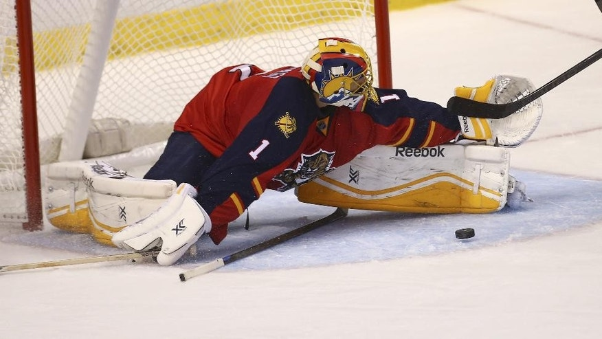 Florida Panthers' goalie Roberto Luongo (1) blocks an Arizona Coyotes shot on goal during the second period of a NHL hockey game in Sunrise, Fla., Thursday, Oct. 30, 2014. (AP Photo/J Pat Carter