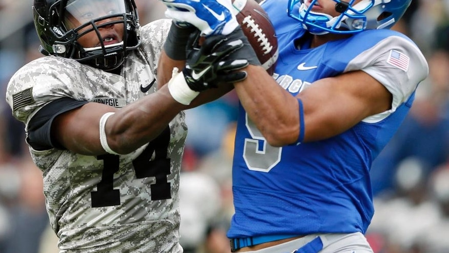 Army defensive back Chris Carnegie (14) breaks up a pass for Air Force wide receiver Jalen Robinette (9) during the first half of an NCAA college football game Saturday, Nov. 1, 2014, in West Point, N.Y. (AP Photo/Mike Groll)