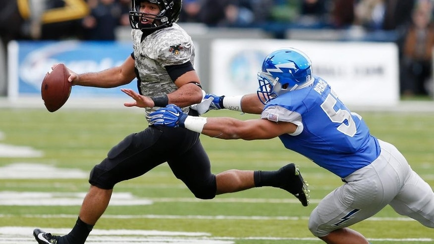 Army quarterback Angel Santiago (3) eludes Air Force linebacker Jordan Pierce (51) during the first half of an NCAA college football game Saturday, Nov. 1, 2014, in West Point, N.Y. (AP Photo/Mike Groll)