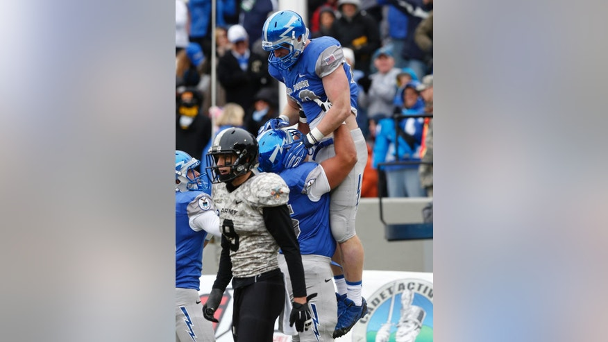 Air Force tight end Garrett Griffin (80) celebrates with teammates after scoring a touchdown on a long run after catch during the second half of an NCAA college football game against Army on Saturday, Nov. 1, 2014, in West Point, N.Y. Air Force won 23-6. (AP Photo/Mike Groll)