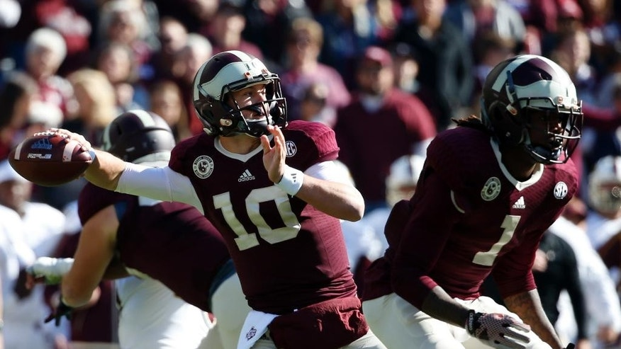 Texas A&M quarterback Kyle Allen (10) passes as running back Brandon Williams (1) provides protection in the first half of an NCAA college football game against Louisiana Monroe, Saturday, Nov. 1, 2014, in College Station, Texas. (AP Photo/Tony Gutierrez)