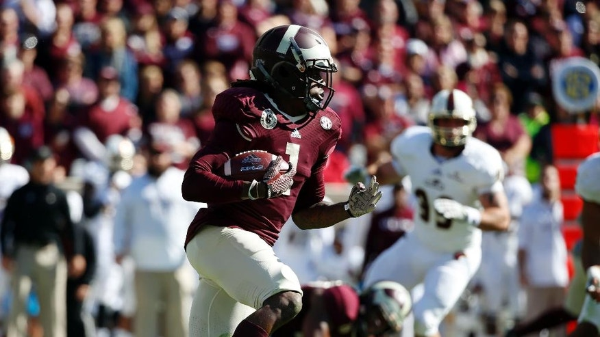 Texas A&M running back Brandon Williams (1) finds running room against Louisiana Monroe in the first half of an NCAA college football game, Saturday, Nov. 1, 2014, in College Station, Texas. (AP Photo/Tony Gutierrez)