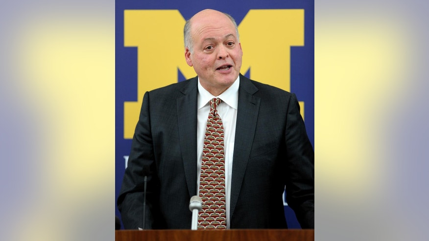 Former Steelcase CEO Jim Hackett speaks after being introduced as the University of Michigan's interim athletic director during a news conference in Ann Arbor, Mich., Friday, Oct. 31, 2014. University of Michigan President Mark Schlissel announced that athletic director Dave Brandon resigned. (AP Photo/Detroit News, Todd McInturf) DETROIT FREE PRESS OUT; HUFFINGTON POST OUT