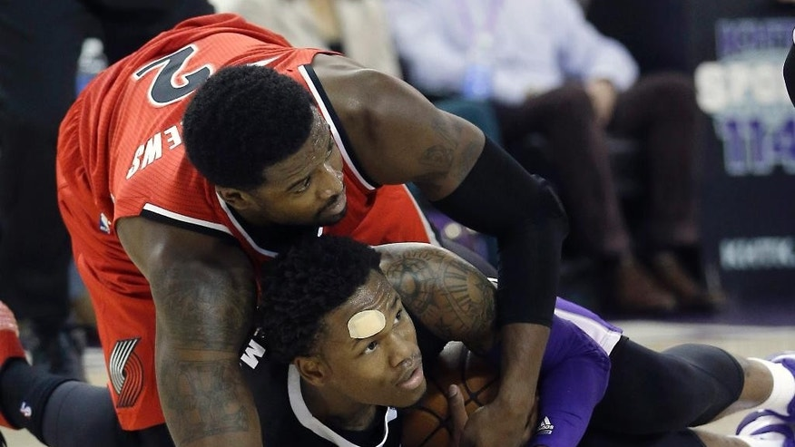 Portland Trail Blazers guard Wes Matthews, left, and Sacramento Kings guard Ben McLemore  battle for the ball during the first quarter of an NBA basketball game in Sacramento, Calif. Friday, Oct. 31, 2014.(AP Photo/Rich Pedroncelli)