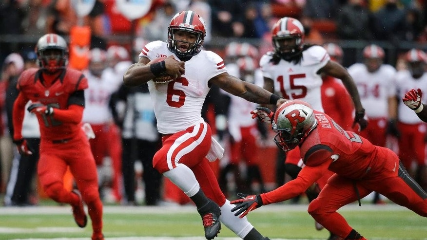 Wisconsin running back Corey Clement (6) runs for a touchdown as he breaks a tackle attempt by Rutgers defensive back Gareef Glashen (2) during the first half of an NCAA college football game against Rutgers, Saturday, Nov. 1, 2014, in Piscataway, N.J. (AP Photo/Mel Evans)