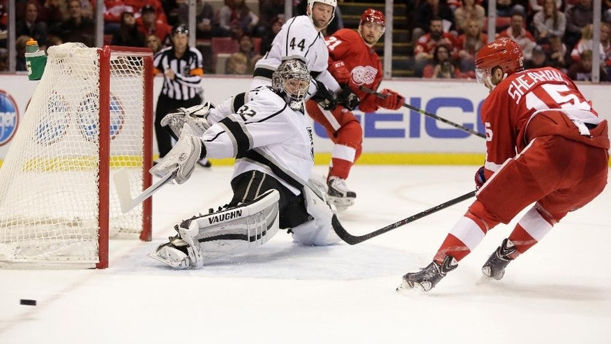 Los Angeles Kings goalie Jonathan Quick (32) deflects a shot by Detroit Red Wings' Riley Sheahan (15) during the second period of an NHL hockey games Friday, Oct. 31, 2014, in Detroit. (AP Photo/Duane Burleson)
