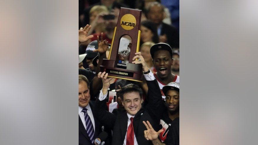 ADVANCE FOR WEEKEND EDITIONS, NOV. 1-2 - FILE - In this April 8, 2013, file photo, Louisville players and head coach Rick Pitino, center, celebrate after defeating Michigan 82-76 at the NCAA Final Four tournament college basketball championship game in Atlanta. The Atlantic Coast Conference had an impressive enough roster of Naismith Hall of Fame coaches before expansion with Duke's Mike Krzyzewski and North Carolina's Roy Williams. Then it added Syracuse's Jim Boeheim last year, and now is bringing in Louisville's Rick Pitino. It's a group with nine NCAA championships combined and now they're going to be fighting each other for an ACC title. (AP Photo/Chris O'Meara, File)