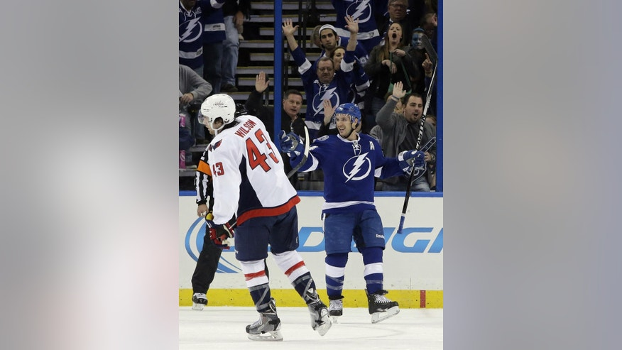 Tampa Bay Lightning right wing Ryan Callahan, right, celebrates his goal against the Washington Capitals during the first period of an NHL hockey game Saturday, Nov. 1, 2014, in Tampa, Fla. Capitals' Tom Wilson (43) skates away. (AP Photo/Chris O'Meara)