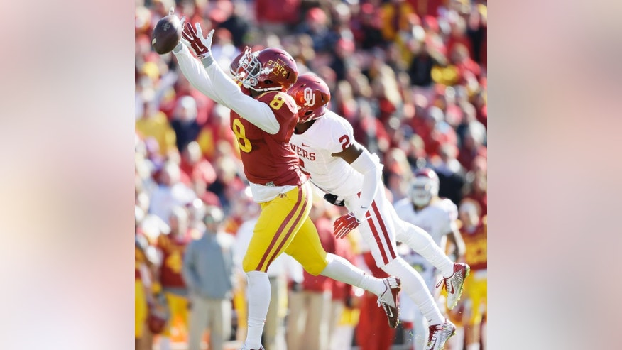 Oklahoma cornerback Julian Wilson, right, breaks up a pass intended for Iowa State wide receiver D'Vario Montgomery (8) during the first half of an NCAA college football game, Saturday, Nov. 1, 2014, in Ames, Iowa. (AP Photo/Charlie Neibergall)