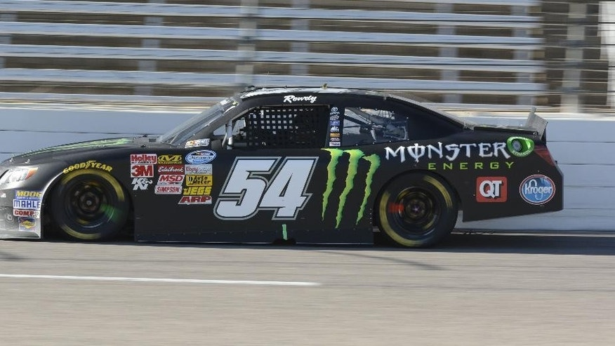 Kyle Busch races through Turn 4 during the NASCAR Nationwide series auto race at Texas Motor Speedway in Fort Worth, Texas, Saturday, Nov. 1, 2014. (AP Photo/Larry Papke)