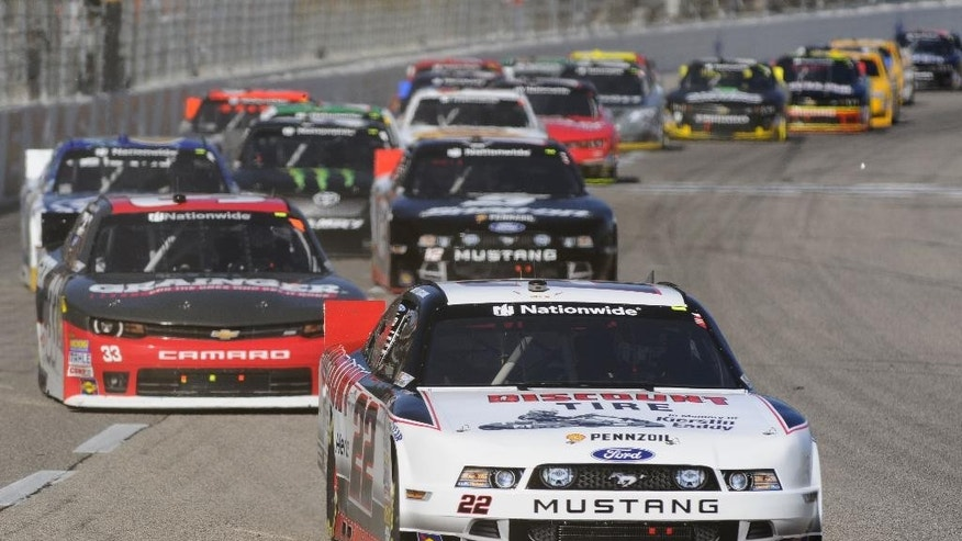 Nationwide Series driver Joey Logano (22) leads the field during the NASCAR Nationwide Series auto race at Texas Motor Speedway in Fort Worth, Texas, Saturday, Nov. 1, 2014. (AP Photo/Ralph Lauer)