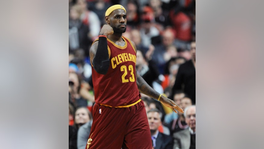 Cleveland Cavaliers' LeBron James pumps his fist after scoring during overtime of an NBA basketball game against the Chicago Bulls in Chicago, Friday, Oct. 31, 2014. Cleveland won 114-108 in overtime. (AP Photo/Paul Beaty)