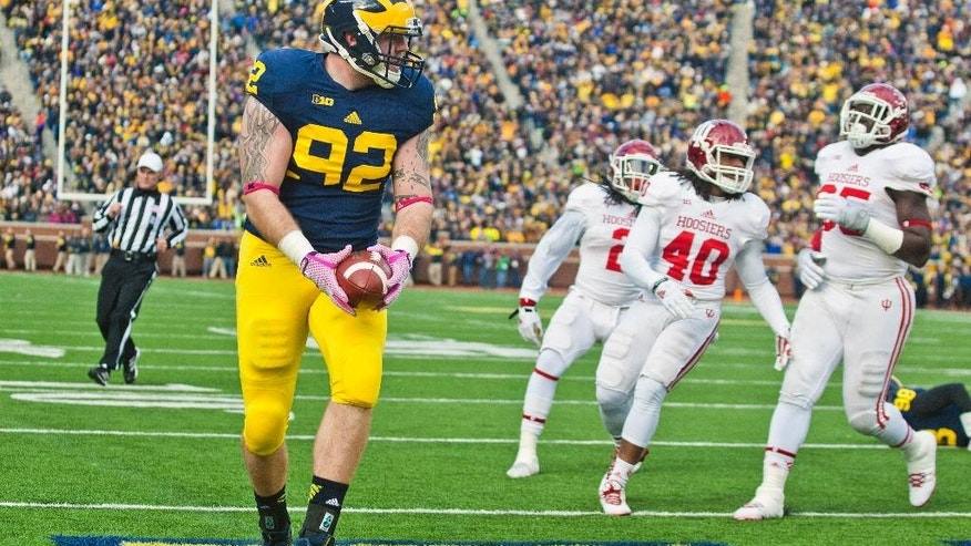 Michigan tight end Keith Heitzman (92) makes a touchdown catch in the first quarter of an NCAA college football game against Indiana in Ann Arbor, Mich., Saturday, Nov. 1, 2014. (AP Photo/Tony Ding)