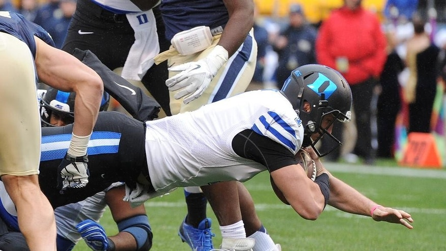 Duke quarterback Thomas Sirk (1) scores a touchdown against Pittsburgh during the second quarter of an NCAA college football game on Saturday, Nov. 1, 2014, in Pittsburgh. (AP Photo/Don Wright)