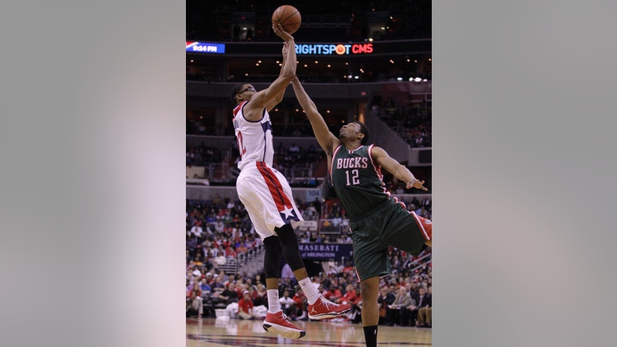 Washington Wizards' Otto Porter (22) shoots the ball over Milwaukee Bucks' Jabari Parker (12) during the second half of an NBA basketball game, Saturday, Nov. 1, 2014, in Washington. The Wizards won 108-97. (AP Photo/Luis M. Alvarez)