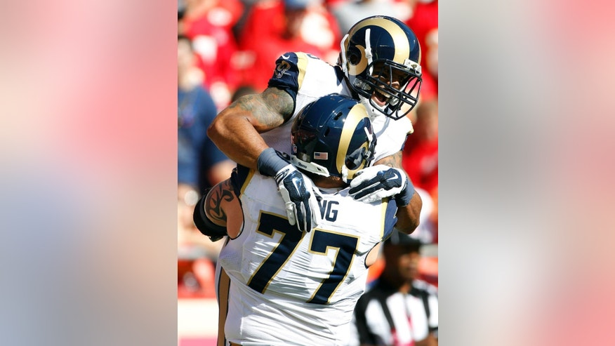 St. Louis Rams tight end Lance Kendricks, top, celebrates a touchdown against the Kansas City Chiefs with tackle Jake Long (77) in the first half of an NFL football game in Kansas City, Mo., Sunday, Oct. 26, 2014. (AP Photo/Colin E. Braley)