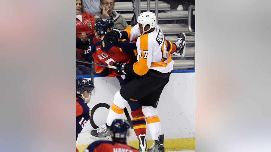 Philadelphia Flyers right wing Wayne Simmonds (17) checks Florida Panthers defenseman Dmitry Kulikov (7) in the second period of an NHL hockey game in Sunrise, Fla., Saturday, Nov. 1, 2014. (AP Photo/Alan Diaz)