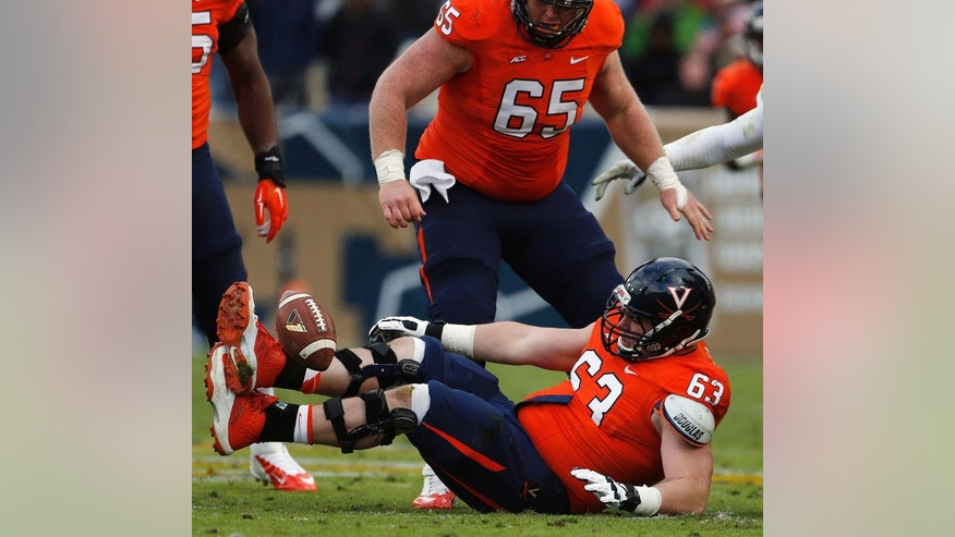 Virginia guard Ryan Doull (63) recovers a fumble against Georgia Tech during the first half of an NCAA college football game, Saturday, Nov. 1, 2014, in Atlanta. (AP Photo/Mike Stewart)