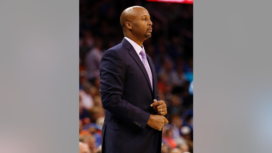 Denver Nuggets Head Coach Brian Shaw looks on in the first half of an NBA basketball game in Oklahoma City, Saturday, Nov. 1, 2014. (AP Photo/Garett Fisbeck)