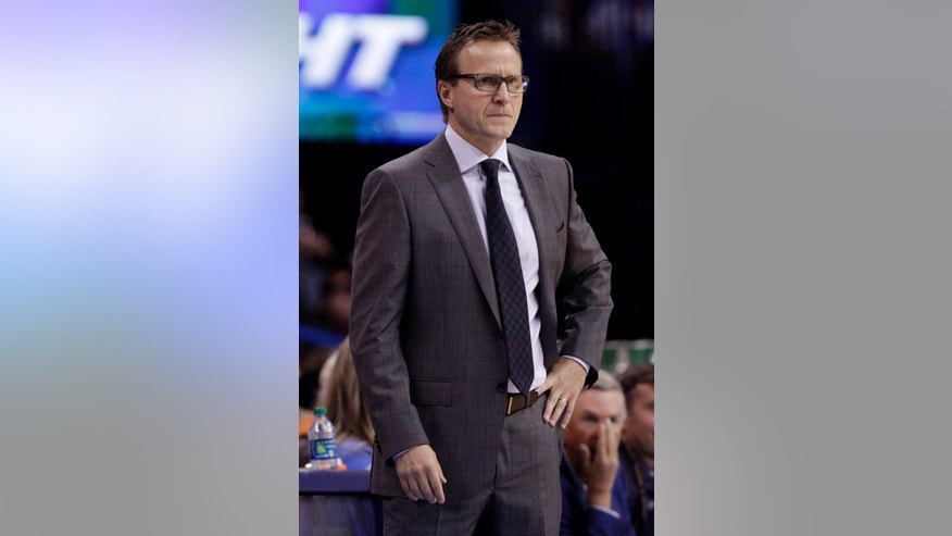 Oklahoma City Thunder Head Coach Scott Brooks looks on in the first half of an NBA basketball game in Oklahoma City, Saturday, Nov. 1, 2014. (AP Photo/Garett Fisbeck)
