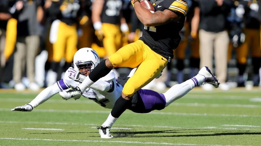 Iowa wide receiver Kevonte Martin-Manley (11) breaks away from Northwestern safety Godwin Igwebuike (16) after catching a pass during the first half of an NCAA college football game, Saturday, Nov. 1, 2014, in Iowa City, Iowa . (Justin Hayworth/AP Photo)