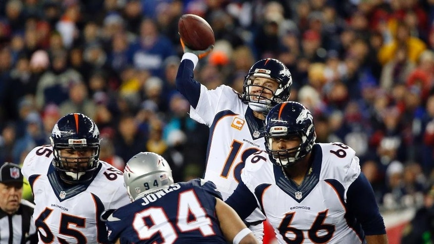 Denver Broncos quarterback Peyton Manning (18) passes against the New England Patriots in the first half of an NFL football game on Sunday, Nov. 2, 2014, in Foxborough, Mass. (AP Photo/Elise Amendola)