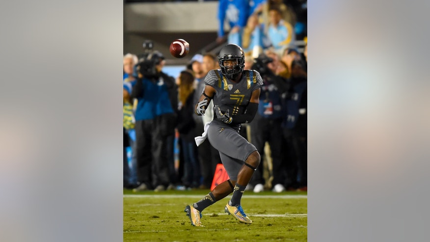 UCLA wide receiver Devin Fuller makes a reception during the first half of an NCAA college football game against Arizona, Saturday, Nov. 1, 2014, in Pasadena, Calif. (AP Photo/Gus Ruelas)