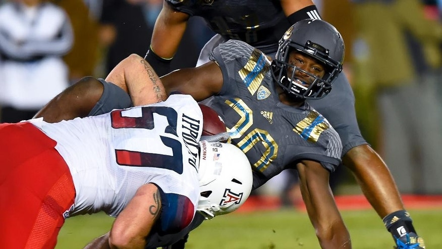 UCLA running back Myles Jack (30) is stopped by Arizona linebacker Cody Ippolito (57) at the goal line during the first half of an NCAA college football game, Saturday, Nov. 1, 2014, in Pasadena, Calif. (AP Photo/Gus Ruelas)