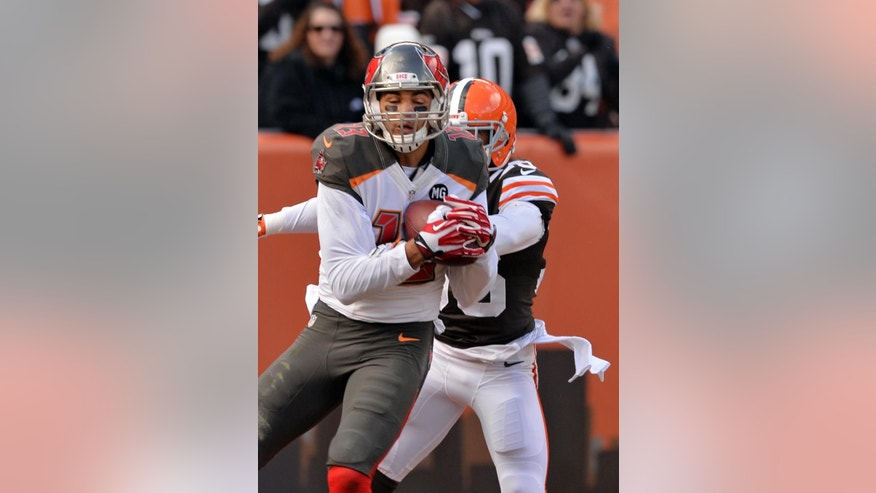 Tampa Bay Buccaneers wide receiver Mike Evans catches a touchdown pass against Cleveland Browns defensive back K'Waun Williams in the second quarter of an NFL football game, Sunday, Nov. 2, 2014, in Cleveland. (AP Photo/David Richard)