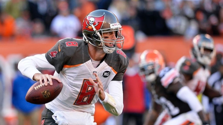 Tampa Bay Buccaneers quarterback Mike Glennon scrambles in the fourth quarter of an NFL football game against the Cleveland Browns, Sunday, Nov. 2, 2014, in Cleveland. (AP Photo/David Richard)