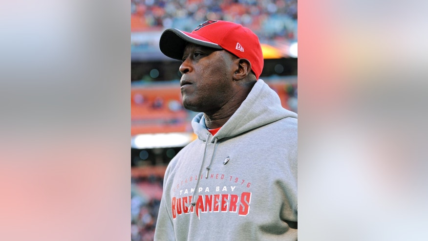 Tampa Bay Buccaneers head coach Lovie Smith walks off the field after a 22-17 loss to the Cleveland Browns in an NFL football game Sunday, Nov. 2, 2014, in Cleveland. (AP Photo/David Richard)