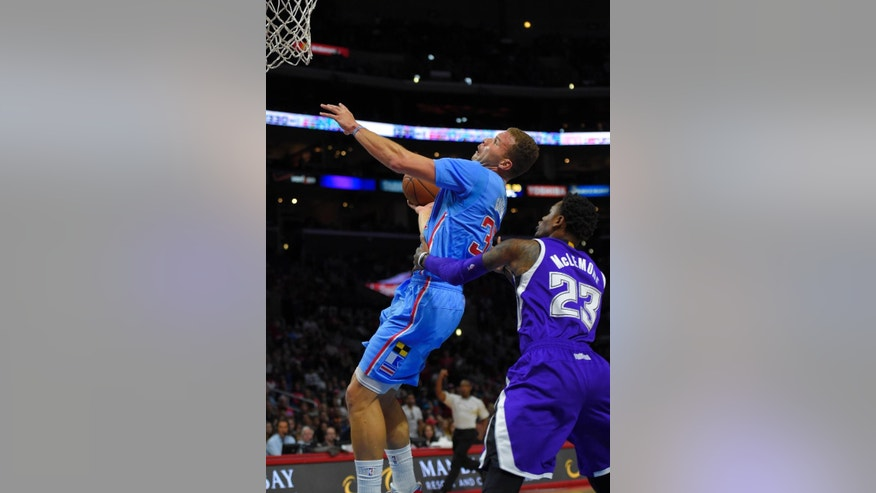 Los Angeles Clippers forward Blake Griffin, left, is fouled by Sacramento Kings guard Ben McLemore during the first half of an NBA basketball game, Sunday, Nov. 2, 2014, in Los Angeles.  (AP Photo/Mark J. Terrill)