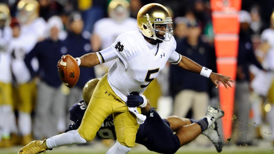 Notre Dame quarterback Everett Golson (5) spins away from Navy defensive end Will Anthony (90) during the first half an NCAA college football game Saturday, Nov. 1, 2014, in Landover, Md. (AP Photo/Nick Wass)