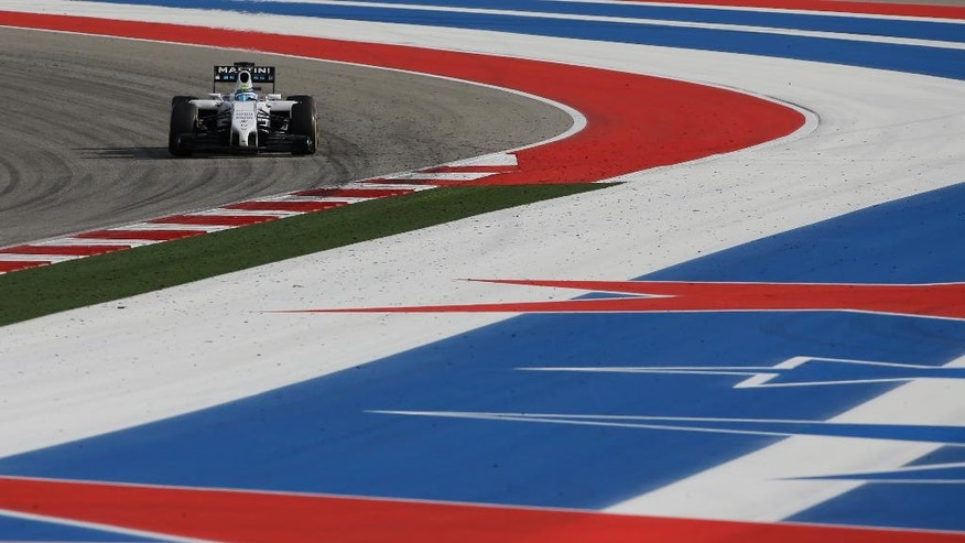 Williams driver Felipe Massa, of Brazil, races his car during the Formula One U.S. Grand Prix auto race at the Circuit of the Americas, Sunday, Nov. 2, 2014, in Austin, Texas. (AP Photo/David J. Phillip)