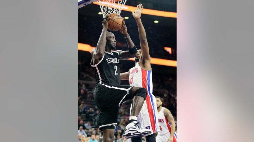 Brookyn Nets' Kevin Garnett (2) looks to pass the ball against the defense from Detroit Pistons' Andre Drummond (0) during the first half of an NBA basketball game Saturday, Nov. 1, 2014, in Auburn Hills, Mich. (AP Photo/Duane Burleson)