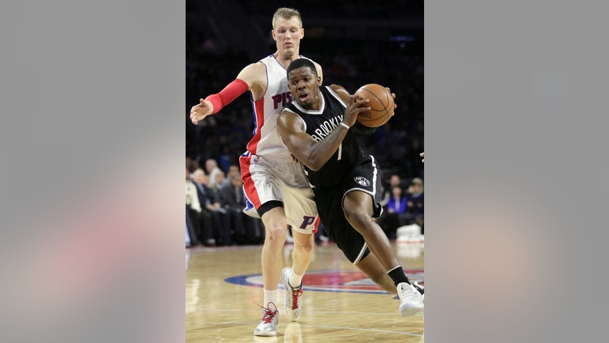 Brookyn Nets' Joe Johnson (7) drives to the basket past Detroit Pistons' Kyle Singler (25) during the first half of an NBA basketball game Saturday, Nov. 1, 2014, in Auburn Hills, Mich. (AP Photo/Duane Burleson)