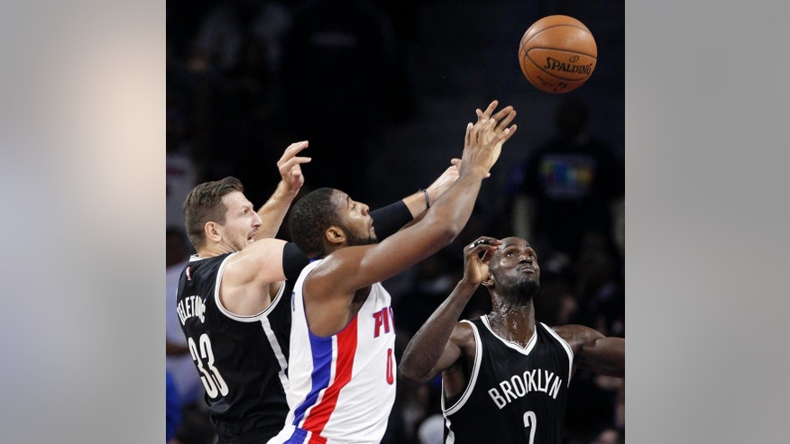 Detroit Pistons' Andre Drummond (0) tries to grab a loose ball against Brookyn Nets' Mirza Teletovic (33) and Kevin Garnett (2) during the first half of an NBA basketball game Saturday, Nov. 1, 2014, in Auburn Hills, Mich. (AP Photo/Duane Burleson)