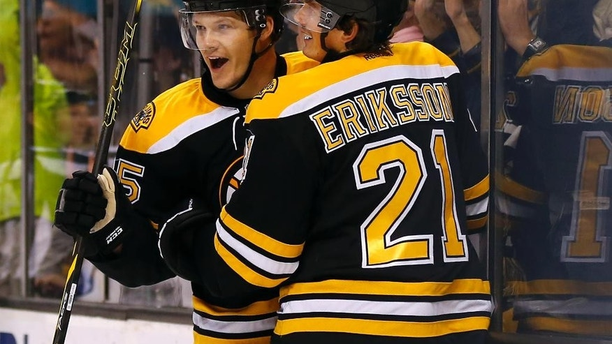Boston Bruins' Matt Fraser celebrates his second goal of the game with Loui Eriksson during the second period of a NHL hockey game against the Ottawa Senators in Boston, Saturday, Nov. 1, 2014. (AP Photo/Winslow Townson)