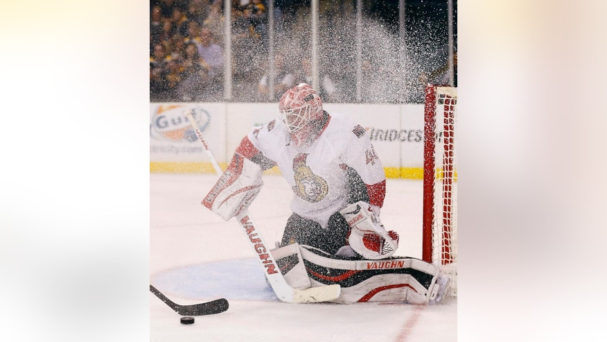 Ottawa Senators goalie Robin Lehner battles a snow spray to see the puck during the second period of a NHL hockey game against the Boston Bruins in Boston, Saturday, Nov. 1, 2014. (AP Photo/Winslow Townson)