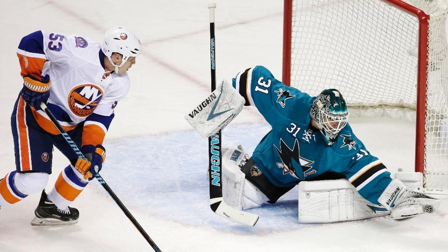 San Jose Sharks goalie Antti Niemi (31), of Finland, stops a shot next to New York second period of an NHL hockey game Saturday, Nov. 1, 2014, in San Jose, Calif. (AP Photo/Marcio Jose Sanchez)
