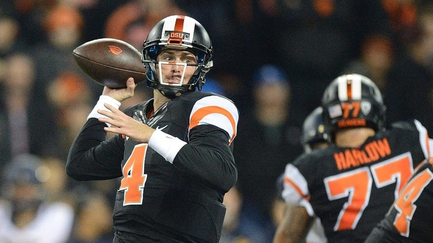 Oregon State quarterback Sean Mannion (4) passes against California during an NCAA college football game in Corvallis, Ore., Saturday, Nov. 1, 2014. (AP Photo/Troy Wayrynen)