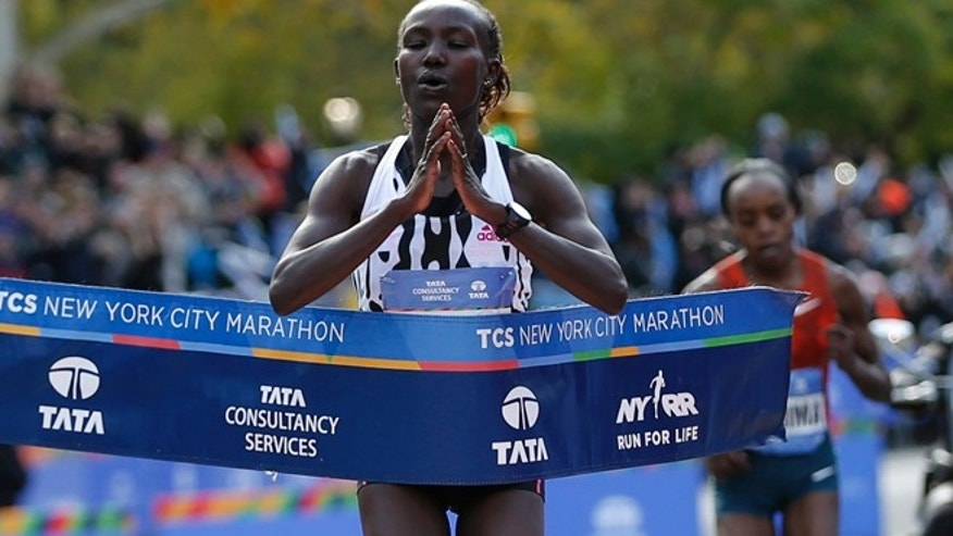 Nov. 2, 2014: Mary Keitany of Kenya crosses the finish line to win the women's professional division of the 2014 New York City Marathon in Central Park in Manhattan. (Reuters)