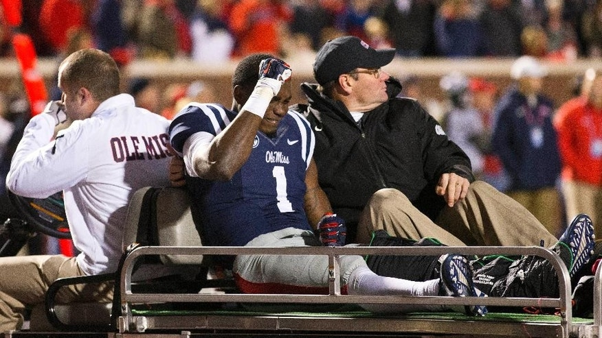 Mississippi wide receiver Laquon Treadwell (1) reacts as he is taken off the field after being injured during the end of the second half of an NCAA college football game, Saturday, Nov. 1, 2014, in Oxford, Miss. Treadwell fumbled the ball at the Auburn goal line. Auburn won 35-31. (AP Photo/Brynn Anderson)