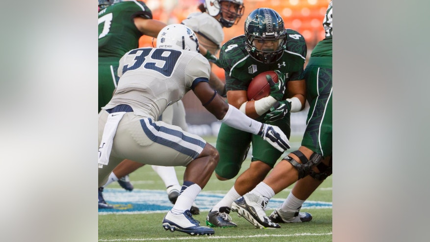 Utah State linebacker Torrey Green (39) tries to cut off Hawaii running back Steven Lakalaka (4) during the first quarter of an NCAA college football game, Saturday, Nov. 1, 2014, in Honolulu. (AP Photo/Eugene Tanner)