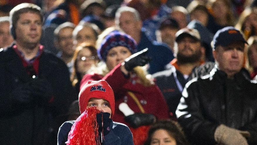 A Mississippi fan reacts as Auburn pulls ahead of Mississippi during the second half of an NCAA college football game, Saturday, Nov. 1, 2014, in Oxford, Miss. Auburn won 35-31. (AP Photo/Brynn Anderson)