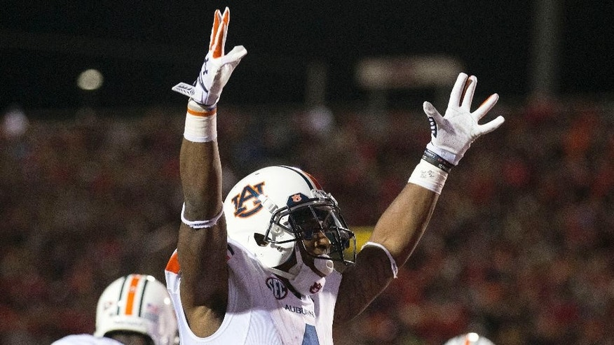 Auburn wide receiver Quan Bray (4) celebrates after quarterback Nick Marshall scored a touchdown during the second half of an NCAA college football game against Mississippi, Saturday, Nov. 1, 2014, in Oxford, Miss. (AP Photo/Brynn Anderson)